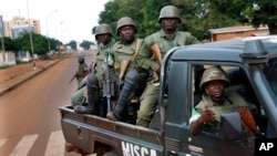 FILE - African Union MISCA troops from Cameroon patrol in Bangui, Central African Republic, May 29, 2014.
