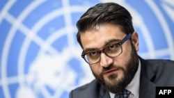"FILE - Afghan National Security Adviser Hamdullah Mohib is pictured at a press conference in Geneva, Nov. 28, 2018. He told reporters in Washington on March 14, 2019, that the U.S. peace strategy in Afghanistan was ""ostracizing and alienating"" the Afghan"