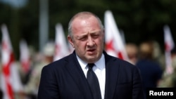 FILE - Georgia's President Giorgi Margvelashvili speaks to media after a ceremony at the memorial cemetery of the Georgian soldiers killed during the war with Russia over the breakaway region of South Ossetia in 2008 in Tbilisi, Georgia, Aug. 8, 2017.