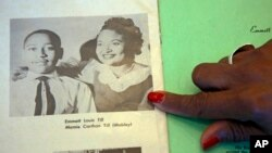 Deborah Watts of Minneapolis, points out a widely seen 1950s photograph of her cousin Emmett Till and his mother, Mamie Till Mobley, during a visit to Jackson, Miss., Aug. 27, 2015.