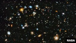 FILE - Astronomers using NASA's Hubble Space Telescope assemble a comprehensive picture of the evolving universe – among the most colorful deep space images ever captured by the 24-year-old telescope.