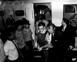 This 1968 photo released by the Shelby County Register's office on March 31, 2011 shows James Earl Ray being transported in Memphis, Tennessee. (REUTERS/Shelby County Register of Deeds)