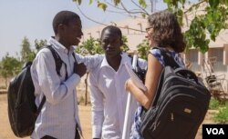 Robin Hinders chats with her students at the University of Thies in Thies, Senegal
