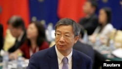 China's central bank governor Yi Gang arrives for the EU-China High-level Economic Dialogue at Diaoyutai State Guesthouse in Beijing, June 25, 2018.