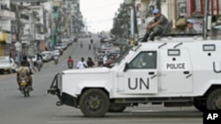 FILE - United Nations peacekeepers patrol along a street in Monrovia, Liberia, Nov. 8, 2011. Missions in Haiti, Liberia, Ivory Coast and Mali accounted for nearly 40 percent of peacekeeper-related abuse allegations in 2015.