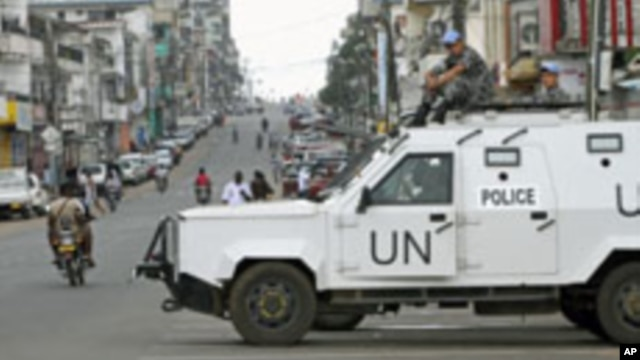 FILE - United Nations peacekeepers patrol Monrovia streets during Liberia's last presidential election runoff, Nov. 8, 2011. Some groups want to extend the current peacekeeping mission through the 2017 elections.