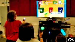 Kids play the University of Utah's Patient Empowerment (PE) video game, September 19, 2012. (University of Utah)