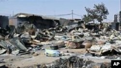 Des maisons détruites lors des violences intercommunautaires de janvier 2010 au Nigeria.