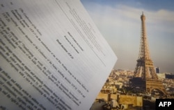 An illustration picture taken on Dec. 10, 2015 in Paris shows a draft for the outcome of the COP21 United Nations conference on climate change next to a picture of the Eiffel Tower. Trump has promised to withdraw from the agreement.