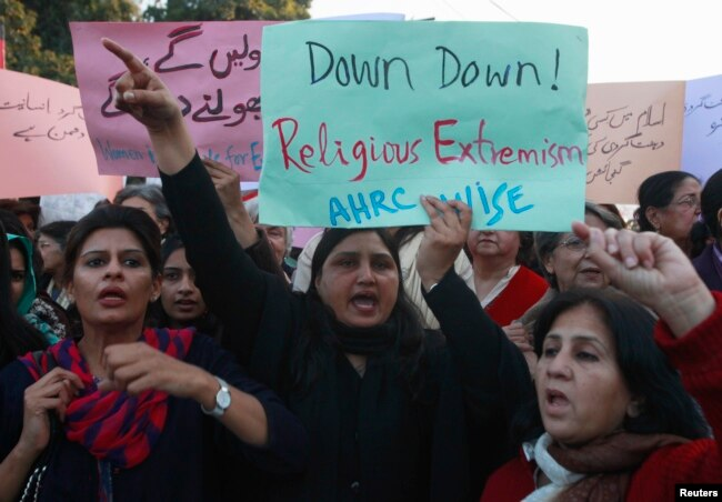FILE - Women chant slogans condemning Islamist terrorism during an anti-terror rally in Lahore, Pakistan, Jan. 16, 2015. Experts say 13 of the approximately 60 U.S.-designated global terrorist organizations are based in Pakistan.