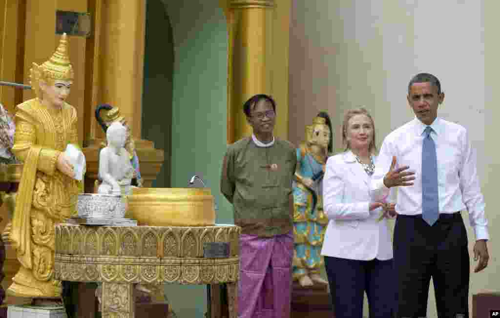 U.S. President Barack Obama speaks to reporters as he tours Shwedagon Pagoda with Secretary of State Hillary Clinton in Rangoon, Burma, November 19, 2012.