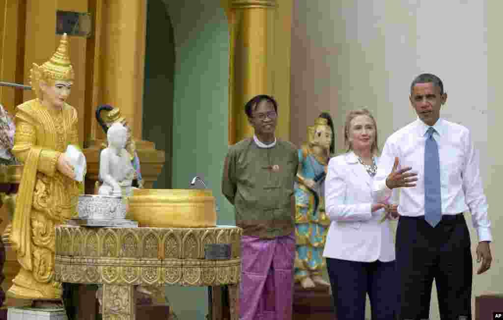 U.S. President Barack Obama speaks to reporters as he tours Shwedagon Pagoda with Secretary of State Hillary Clinton in Rangoon, Burma, November 19, 2012.