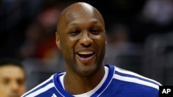 FILE - Los Angeles Clippers' Lamar Odom smiles during an NBA basketball practice in Los Angeles, March 13, 2013.
