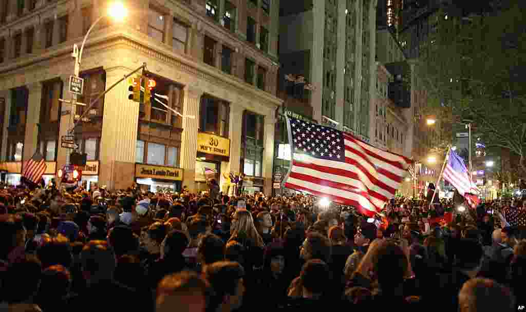 A large crowd reacts to the news of Osama Bin Laden's death near ground zero in New York during the early morning hours of May 2, 2011.