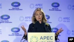 Secretary of State Hillary Rodham Clinton gestures while addressing the Asia-Pacific Economic Cooperation (APEC) Women and the Economy Summit meeting in San Francisco, Friday, Sept. 16, 2011. (AP Photo/Paul Sakuma)