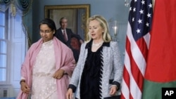 Secretary of State Hillary Rodham Clinton and Bangladeshi Foreign Minister Dipu Moni, arrive to speak with reporters following a bilateral meeting at the State Department in Washington.