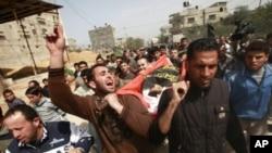 이스라엘의 공습으로 사망한 12살 팔레스타인 소년의 장례식.