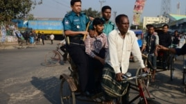 Bangladeshi police transfer a detained activist of Jamaat-e-Islami on a rickshaw during a nationwide strike in Dhaka, December 4, 2012.