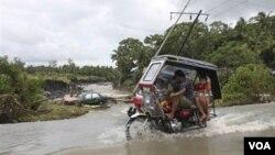 Kota Legazpi di provinsi Albay, Filipina, saat dilanda banjir akibat Badai Nock-ten, 2012. (Foto: Dok)