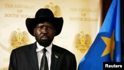 South Sudan's President Salva Kiir, shown here at a news conference in April, says the country's austerity measures could be lifted in January.
