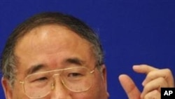 China's top climate change negotiator, Xie Zhenhua, gestures as he answers a question during a press conference, inside the Great Hall of the People in Beijing (File Photo)