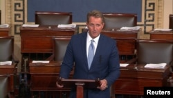 FILE - U.S. Senator Jeff Flake (R-AZ) announces he will not seek re-election as he speaks on the Senate floor in this still image taken from video on Capitol Hill in Washington, Oct. 24, 2017.