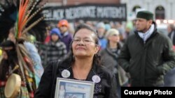 Lynn Eagle Feather protests in a demonstration against the police shooting of her son, Paul Castaway, in July 2015.