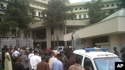 This image released by Saharareporters shows ambulances and rescue workers after a large explosion struck the United Nations' main office in Nigeria's capital Abuja, August 26, 2011