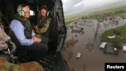 Australian Prime Minister Malcolm Turnbull looks at damaged and flooded areas from aboard an Australian Army helicopter after Cyclone Debbie passed through the area near the town of Bowen, south of the northern Queensland town of Townsville in Australia,