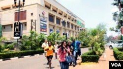 People run from the Westgate Mall in Nairobi, Kenya, after gunmen threw grenades and opened fire during an attack.