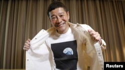 Japanese billionaire Yusaku Maezawa poses with his T-shirt bearing an image of Earth during an interview with Reuters in Tokyo, Japan, March 3, 2021. (REUTERS/Kim Kyung-Hoon)