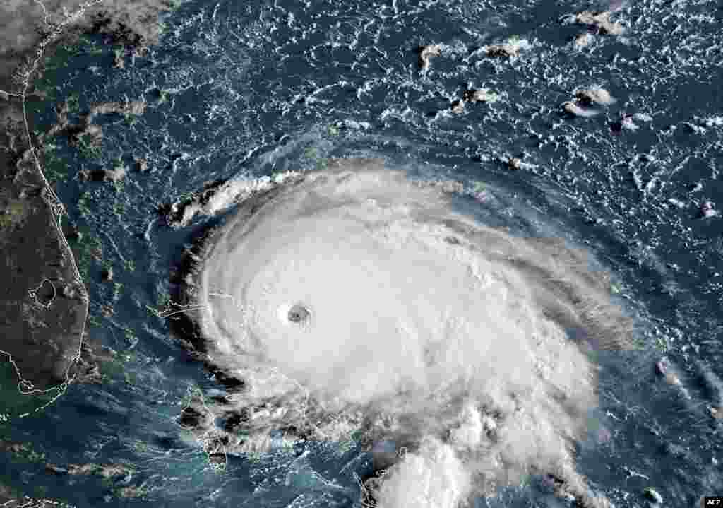 This satellite image obtained from NOAA/RAMMB shows Tropical Storm Dorian as it approaches the Bahamas and Florida at 12:00 UTC. Hurricane Dorian strengthened into a catastrophic Category 5 storm, packing 160 mph (267 kph) winds as it was about to slam into the Abaco Islands in the Bahamas, U.S. weather forecasters said.