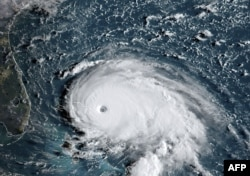 This satellite image from NOAA/RAMMB, shows Tropical Storm Dorian as it approached the Bahamas and Florida, September 1, 2019.