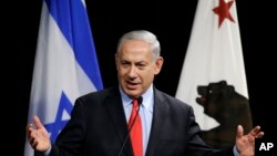 Israeli Prime Minister Benjamin Netanyahu gestures while speaking in Mountain View, California, March 5, 2014.