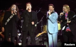 FILE - The Eagles are seen during a concert in Los Angeles to benefit the Recording Artists Coalition, Feb. 16, 2002.