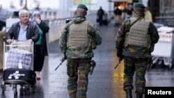 Belgian soldiers patrol at Zaventem international airport near Brussels, Nov. 21, 2015, after security was tightened in Belgium following the fatal attacks in Paris.