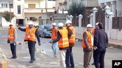Arab League monitors check Al-Sabil area, in Daraa, Syria, January 3, 2012.
