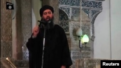 Image taken from recently released video shows man purported to be Abu Bakr al-Baghdadi, ISIL's reclusive leader, making what would be his first public appearance at a mosque in the center of Iraq's second city, Mosul July 5, 2014.