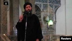 Hình ảnh được cho là của Abu Bakr al-Baghdadi phát biểu trong một video hồi gần đây trong một lần xuất hiện trước công chúng tại một nhà thờ Hồi giáo ở Mosul, ngày 5 tháng 7, 2014.