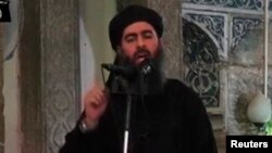 FILE - A video image shows a man purported to be Abu Bakr al-Baghdadi, the Islamic State's senior leader. The video was released in July 2014.