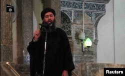 A video image of a man purported to be Abu Bakr al-Baghdadi, the reclusive leader of the Islamic State, in hi s first public appearance in Mosul on July 5, 2014.