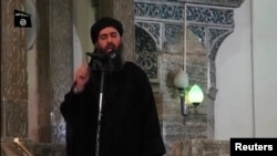 FILE - An image taken from video shows a man purported to be Abu Bakr al-Baghdadi, leader of Islamic State militants, speaking at a mosque in Mosul July 5, 2014.