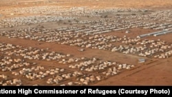 An image of the world's largest refugee camp, Dadaab, in northeastern Kenya, which marked its 20th year in 2012. Originally set up in 1991 to host up to 90,000 refugee, it now is home to more than 300,000 Somalis.