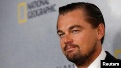 Leonardo DiCaprio berpose sebelum penayangan film dokumenternya di Markas Besar PBB di New York (20/10). (Reuters/Brendan McDermid)