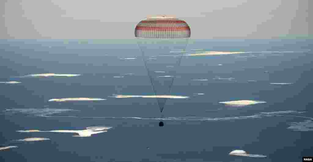The Soyuz MS-02 spacecraft lands with Expedition 50 Commander Shane Kimbrough of NASA and Flight Engineers Sergey Ryzhikov and Andrey Borisenko of Roscosmos near the town of Zhezkazgan, Kazakhstan.