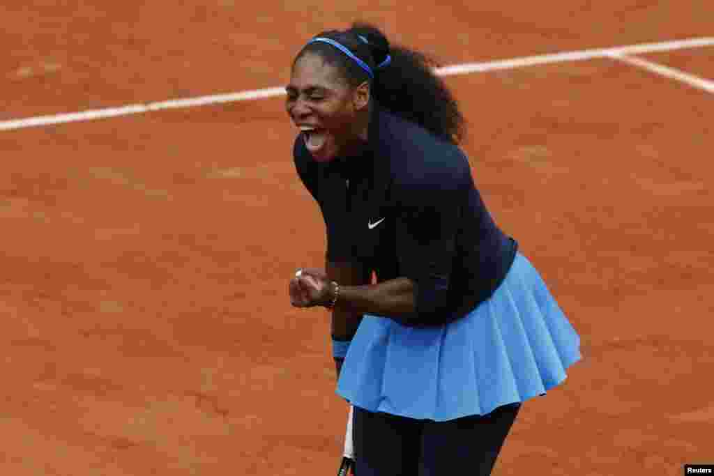 Serena Williams clenches her fist after scoring a point in the French Open Women Singles Semifinal match against Netherlands' Kiki Bertens at the Roland Garros stadium in Paris, France.