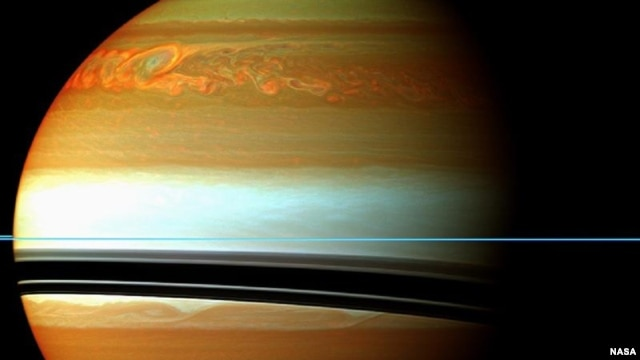 These red, orange and green clouds (false color) in Saturn's northern hemisphere indicate the tail end of a massive storm that started in December 2010.