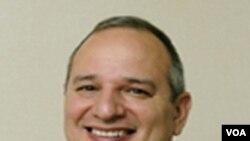 Prezidan Direktè Jeneral ONG IMA Rick Santos