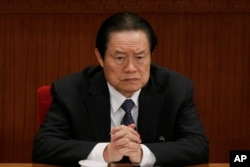 FILE - Zhou Yongkang, then Chinese Communist Party Politburo Standing Committee member in charge of security, attends a plenary session of the National People's Congress at the Great Hall of the People in Beijing.