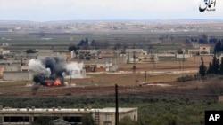伊斯兰国媒体分支的照片显示2017年1月9日土耳其对叙利亚北部阿勒颇省发起的一次导弹袭击画面。